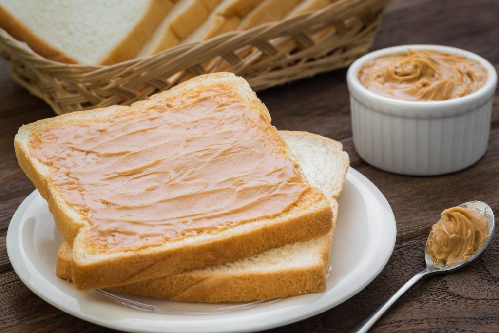 48480210 - peanut butter sandwich on plate